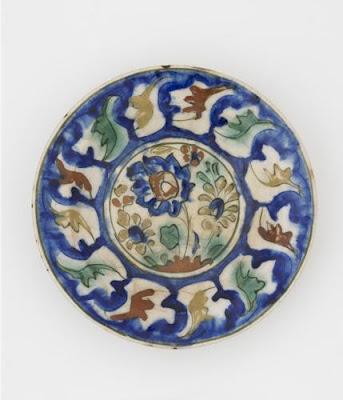 Plate | Origin:  Possibly Tabriz,  Iran | Period: late 16th-early 17th century  Safavid period | Details:  Not Available | Type: Stone-paste painted under colorless glaze | Size: W: 6.8  cm | Museum Code: S1997.55 | Photograph and description taken from Freer and the Sackler (Smithsonian) Museums.