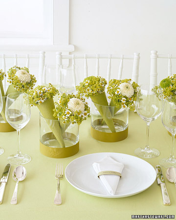 Do double duty by creating centerpieces that guests can also take home as favors after the shower. (marthastewartweddings.com)