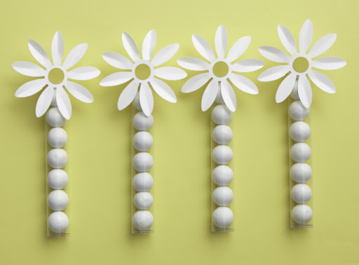 Tubes of gum balls accented with the paper daisy flower makes a great favor. Tubes and paper daisies sold separately.