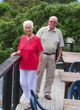 Dorothy and Trevor Waddel enjoying the sea views from the Piha RSA deck. Photo courtesy of Gordon Sutherland