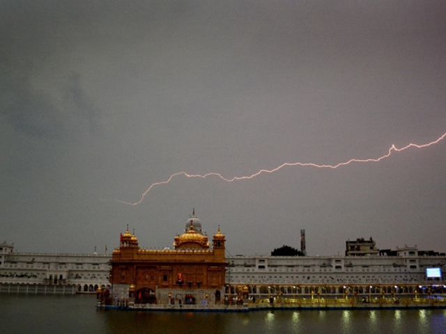 Lightning strikes over the Golden Temple, the holiest Sikh shrine, in Amritsar, India ahead of the storm. Photo: Sanjeev Syal / AP