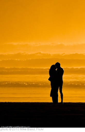 'Lovers embracing on the beach at sundown / sunset on Morro Strand State Beach 10 Jan 2010' photo (c) 2010, Mike Baird - license: http://creativecommons.org/licenses/by/2.0/