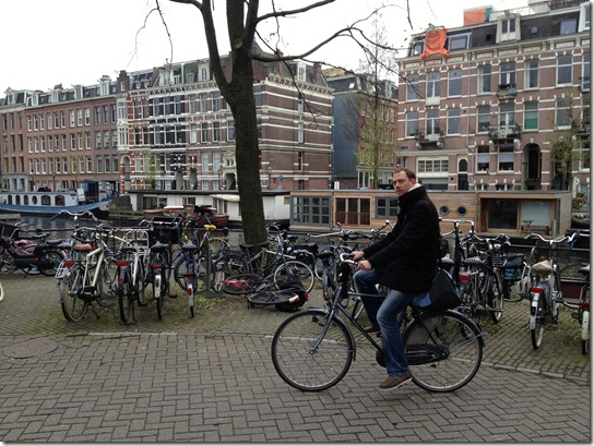 Dirk Eys bicycling in Amsterdam