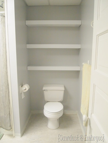cabinets over toilet in bathroom. floating shelves over toilet {sawdust and embryos} cabinets in bathroom