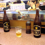 sapporo at convey belt sushi in Roppongi, Tokyo, Japan