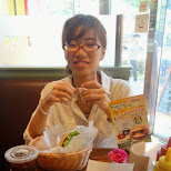 fumie enjoying Freshness burger and my FAN underneath my plate which caused a mess in Shinagawa, Tokyo, Japan