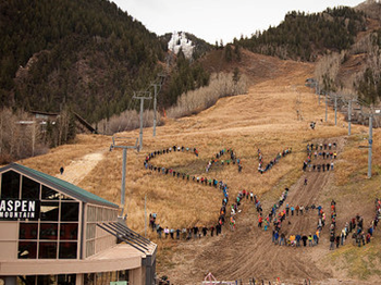 Climate activists spell out the words 'Save Snow' on Aspen Mountain in 2009. americanindependent.com via 350.org