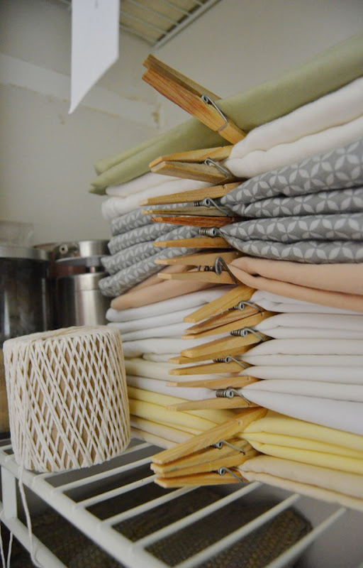 stack of pillowcases with clothespins amy renea a nest for all seasons