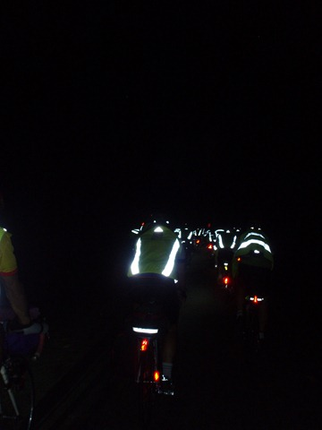Red tail lights and reflective vests spread across western France