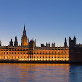 The Palace of Westminster at night as seen from the opposite side of the River Thames