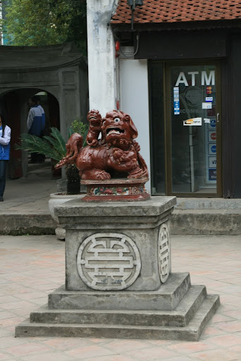 Alongside from strange statues of dogs, you can also find a convenient ATM.