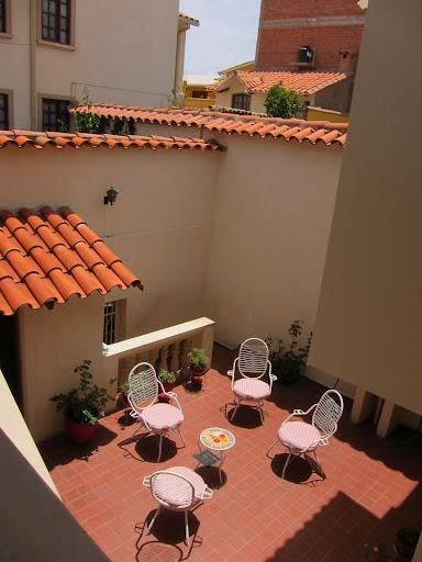 The sunny courtyard at Santa Cecilia Hostel.