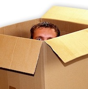 Man peeking out of moving box