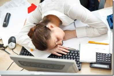 Woman-asleep-on-laptop-at-desk