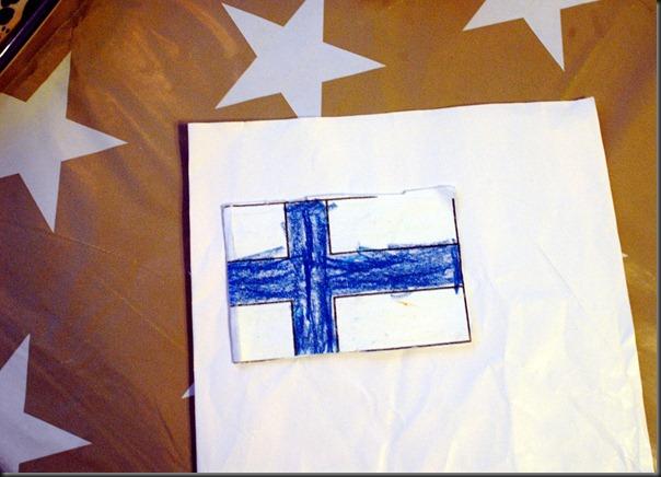 askartele lippu joki jäässä 002