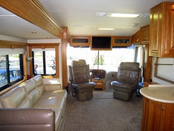 Front cockpit and sofa in main living area.