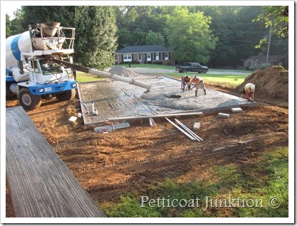 pouring the concrete pad for the workshop