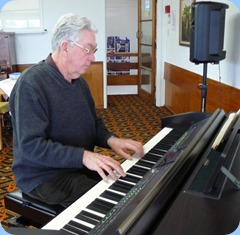 JIm Nicholson playing the Clavinova.  Photo courtesy of Dennis Lyons.