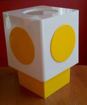 white lamp with yellow circle and yellow base