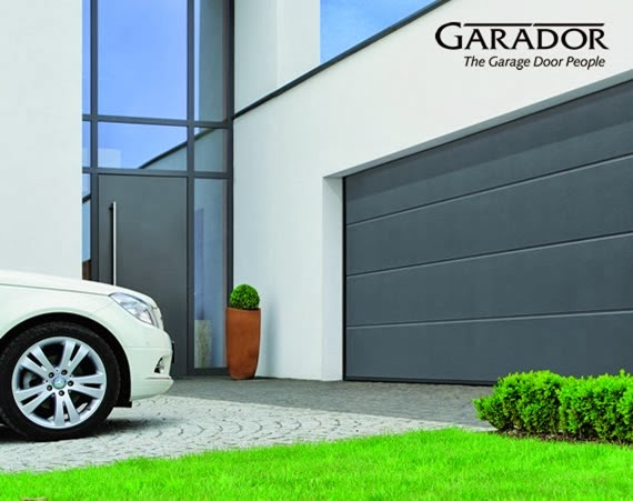 Garador Linear Large sectional garage door and Mercedes Benz car