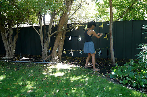 Jen's friend Joanne tests the bird garland.