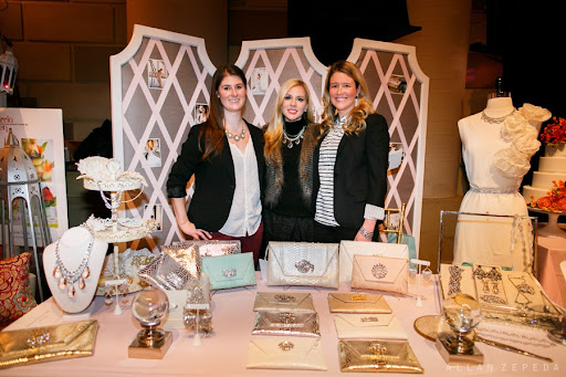 Jackie Weppner of Merci New York with her team at their sparkling booth.