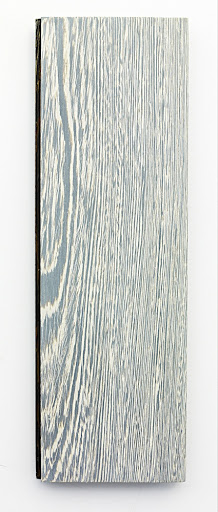 A plainsawn plank with 2 bleach applications and white stain.