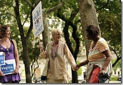 "(caption) Sixty-year-old Laura Freeman of Dearborn smiles as she befriends Inez Boynton of Detroit, who was hanging around in Grand Circus Park and was curious about the assembling protestors for SlutWalk Detroit 2012. Freeman's daughter Maggie McGuire (left) watches the interaction.  *** A vocal group composed predominately of women marched down Woodward Avenue to Hart Plaza and through Greektown chanting the word ""vagina"" along with anti-violence against women slogans during SlutWalk Detroit 2012. Photos taken on Saturday, June 16, 2012.  ( John T. Greilick / The Detroit News )"