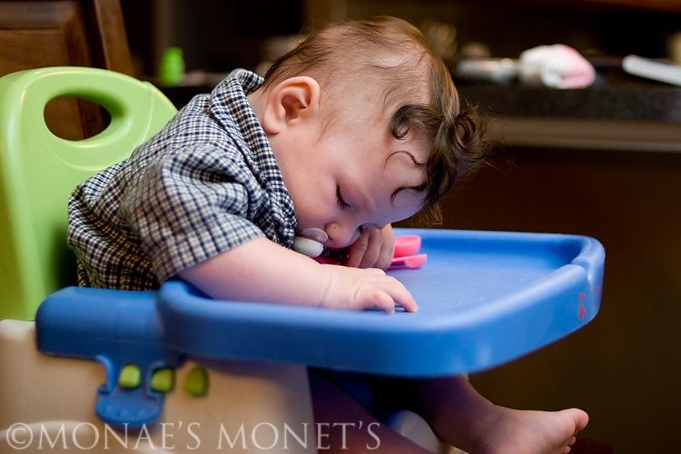 Ryan sleeping in highchair blog