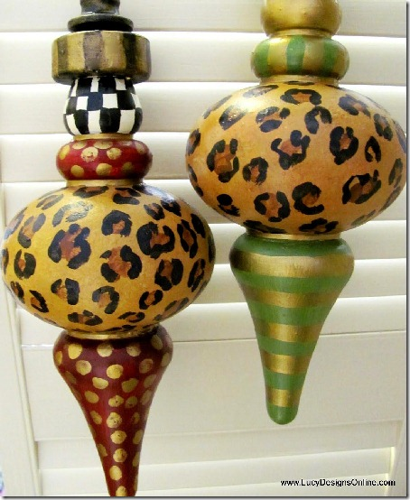 Hand painted ornaments with black and white check, leopard print, gold strips and spots, and various colors.