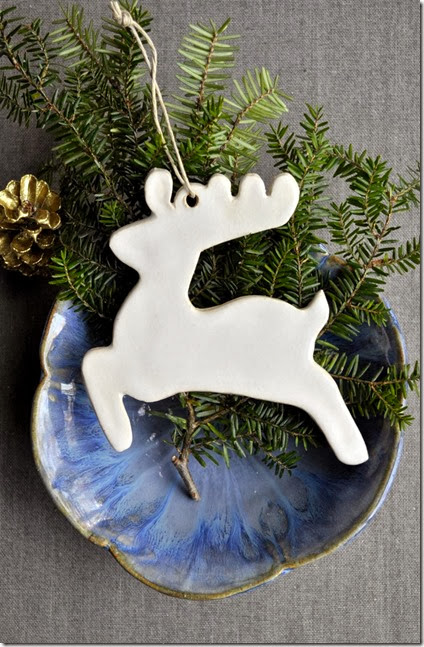 white reindeer ornament in simple display