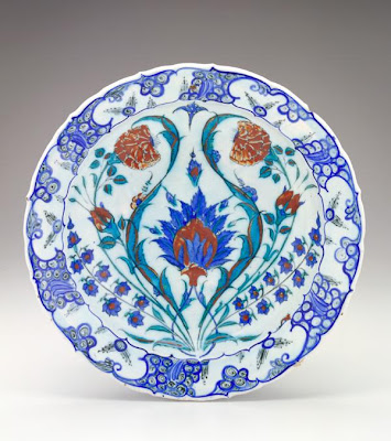 Plate | Origin:  Turkey | Period: 1570-75  Ottoman period | Details:  Not Available | Type: Stone-paste body painted under glaze | Size: H: 6.4  W: 31.7  cm | Museum Code: F1969.25 | Photograph and description taken from Freer and the Sackler (Smithsonian) Museums.