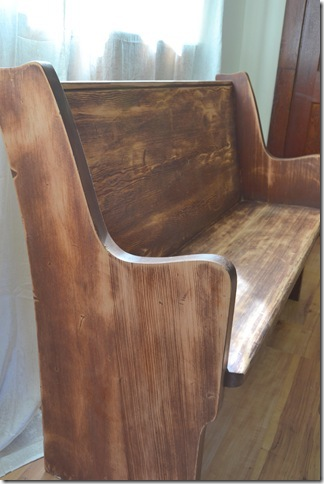 Old wooden church pew sanded with some of the raw wood showing through