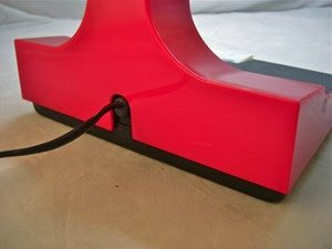 red Mobilite desk lamp rear base