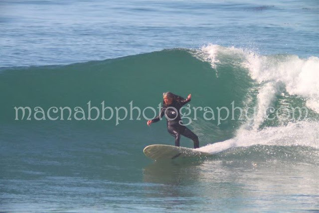 Kim on a backside turn at Swamis looking stylish!