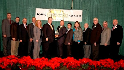 Accepting for Kehl Management are:Gary Bishop, Joe Massa, Dan Franz, Karlyn Ollendick, Dan Kehl, Cody Kehl, Sharon Hasselhoff, Ken Hanson, and Dale Scheibe. Also Kirk Trede and Dave Mohr of Eastern Iowa Light & Power Coop, ABI's Mike Ralston, and IADG's Rand Fisher (photo submitted).