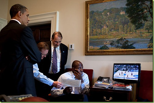 President Barack Obama, Press Secretary Robert Gibbs, Senior Advisor David Axelrod, and personal aide Reggie Love, watch a NCAA Men's Basketball Tournament game in the Outer Oval Office, March 20, 2010.  (Official White House Photo by Pete Souza)