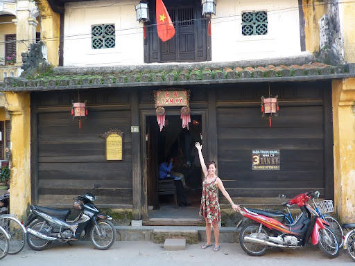 Lynett outside an old merchant house of Hoi An, Tan Ky, home to seven generations of the same family.