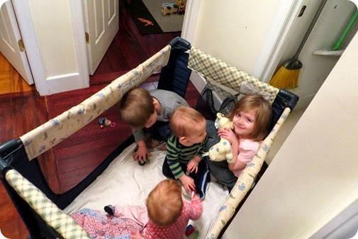 Four kids in a pack n play