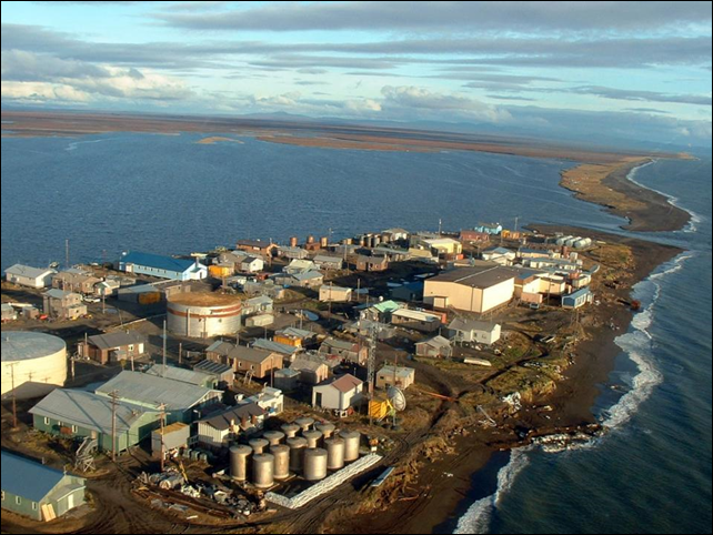 In this photo taken in September 2005 and provided by Millie Hawley, Kivalina, an Inupiat Eskimo village is seen in on a barrier island off the coast of northwest Alaska. Inupiat Eskimo villagers in the Chukchi Sea village of Kivalina rely on wild animals to survive, but a recent arrival associated with climate warming is causing health concerns. Photo: Millie Hawley / AP Photo