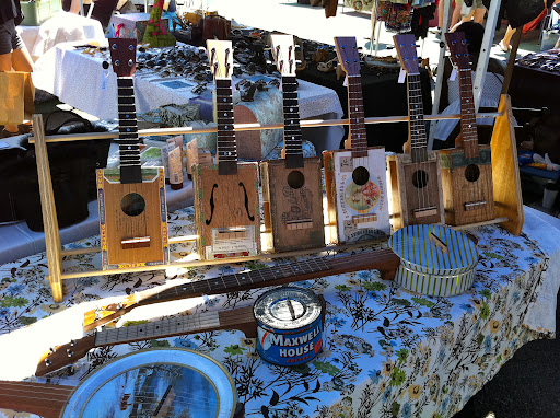 The instruments are made from cigar and coffee boxes.