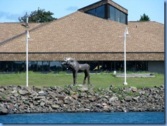 5062 Michigan - Sault Sainte Marie, MI -  St Marys River - Soo Locks Boat Tours - wood carved bull moose on Canadian side