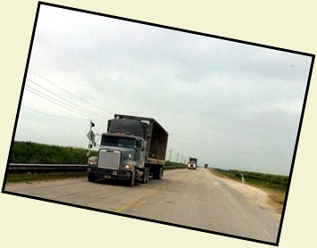 09 - mile after mile of sugar cane trucks
