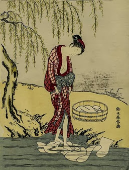 Woman Washing Cloth in a Stream