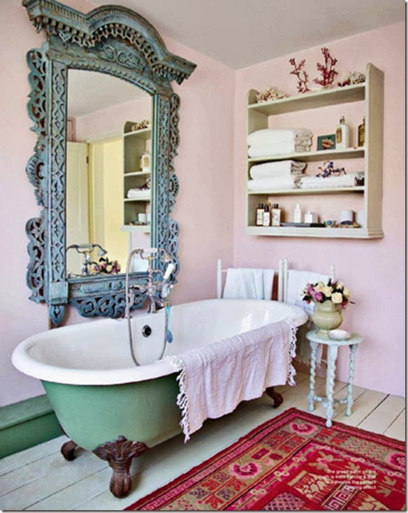 a pink bathroom with clawfoot tub