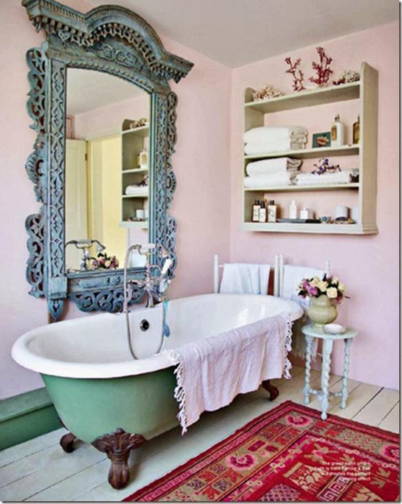 a pink bathroom with clawfoot tub