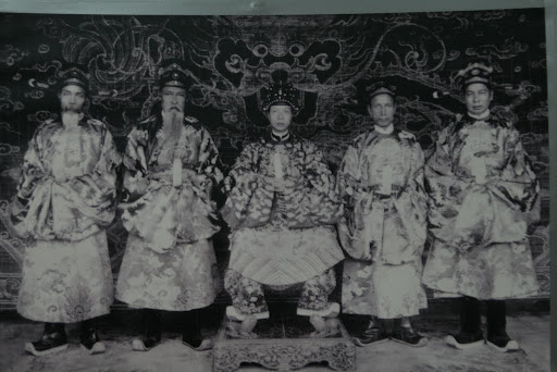 Emporer Khai Dinh and his four highest ranking officials. The guy on his far right scares us.