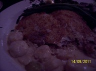 Flounder and Scallops in Champagne Sauce with Grapes over rice