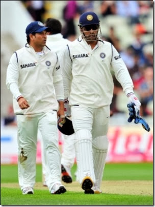 India's Sachin Tendulkar (L) talks to Mahendra Singh Dhoni (R) during the second day of the third test against England at the Edgbaston cricket ground in Birmingham, central England on August 11, 2011.