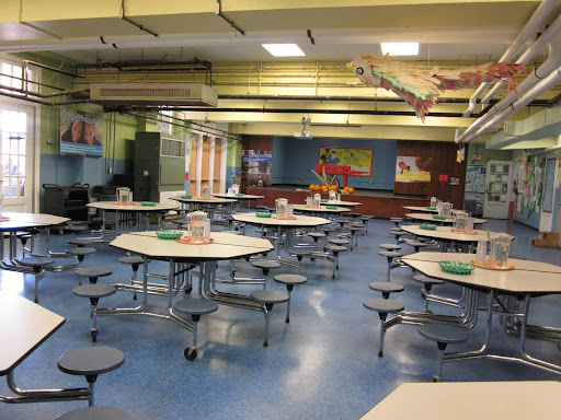 The cafeteria is designed to inspire good manners and appreciation of food, with flowers on the tables and real glasses, plates, and silverware in use.